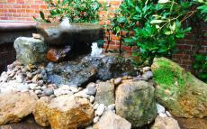 Custom Double Bubbling Rock Fountain by Kingdom Landscaping